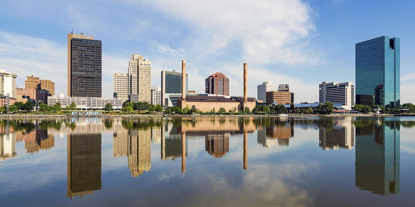 City view of Toledo Ohio reflecting in the river.