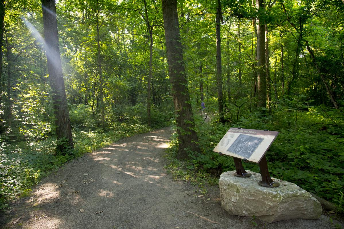 Interpretive signs along a dusty trail at the historic Fallen Timbers Battlefield and Visitors Center.