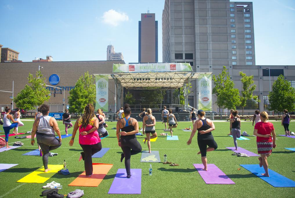 Outdoor summer yoga class at Hensville on a sunny day.