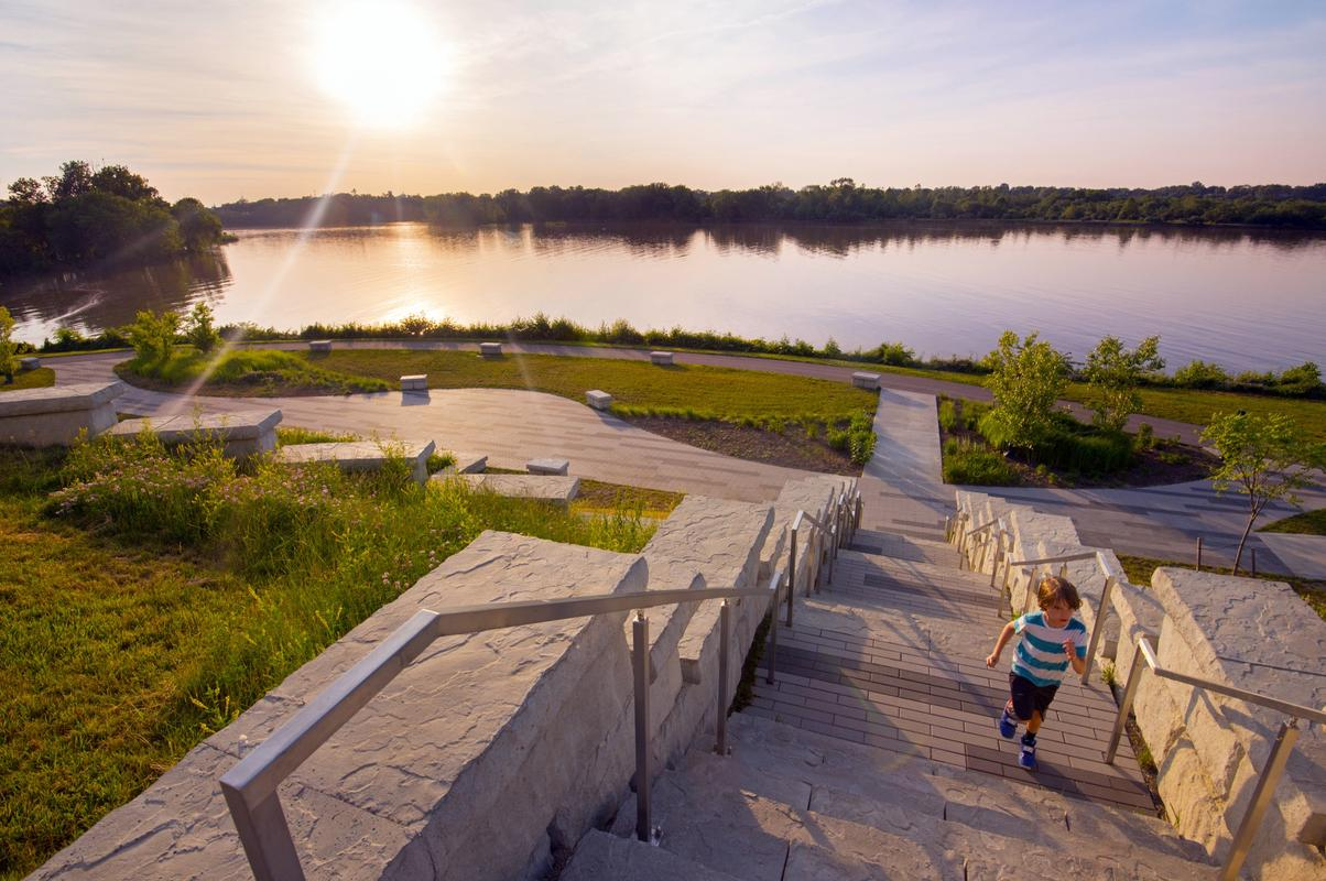 Small child explores the steps at Perrysburg Riverside Park.