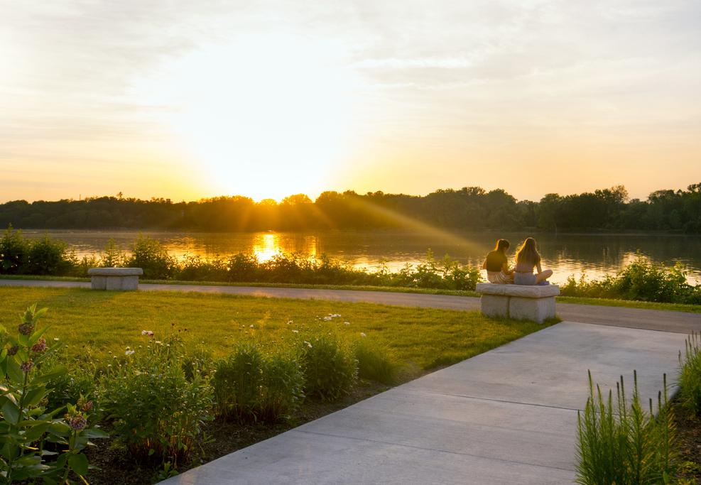 Friends watch the sunset over the river at Perrysburg Riverside Park.